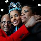 Miss Jamaica 2019, Toni-Ann (centre), embraces her parents Bradshaw Singh and Jahrine Bailey after she is announced Miss World 2019, during the 69th Miss World annual final at the ExCel London. Yui Mok/PA Wire