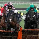 James Bowen and Call Me Lord (right in green) clear the last to win The Unibet International Hurdle at Cheltenham yesterday. Photo: Alan Crowhurst/Getty Images