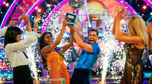 Kelvin Fletcher with Oti Mabuse after the actor won the Glitterball trophy during the live Strictly Come Dancing Final on Saturday.Guy Levy/BBC/PA Wire