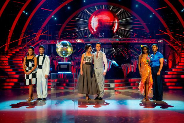 Final three couples (left to right) Amy Dowden and Karim Zeroual, Emma Barton and Anton Du Beke, Oti Mabuse and Kelvin Fletcher wait to hear who won the Glitterball Trophy during the live Strictly Come Dancing Final on Saturday.Guy Levy/BBC/PA Wire