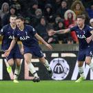 Tottenham Hotspur's Jan Vertonghen celebrates scoring their winning goal with team-mates at Molineux Stadium, Wolverhampton.