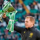 Celtic manager Neil Lennon shows off the Betfred Cup before the Scottish Premiership match against Hibernian at Celtic Park, Glasgow. Photo: Steve Welsh/PA Wire