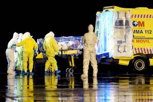 Health workers load Spanish Ebola patient, Catholic priest Manuel Garcia Viejo, into an ambulance on the tarmac of Torrejon airbase after he was repatriated from Sierra Leone for treatment in Spain. Reuters