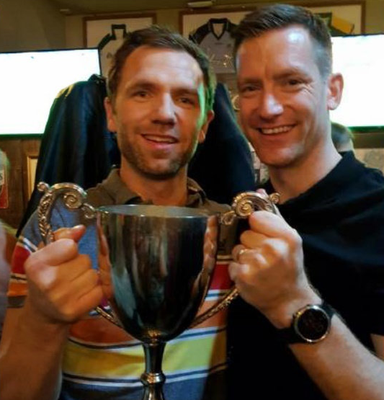 Damien McGovern, from Burren (left) and manager Jimmy Treacy, from Carrickmore, celebrate Glasgow Gaels' 2019 Scottish Championship win. Photo: Reuters/Shohei Miyano/File Photo