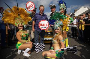 13/09/2014 An Taoiseach Enda Kenny with Brazilian Samba dancers and Police at Cannonball 2014 at the Quay, Ballina, Co. Mayo. Photo : Keith Heneghan