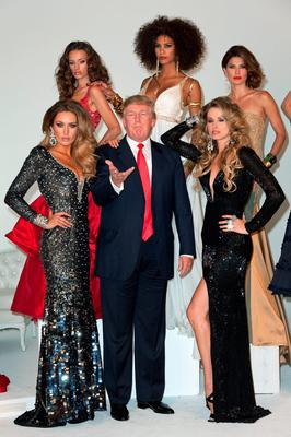 Donald Trump (C) and (L-R) Miss Ireland 2010 Rosanna Purcell, Miss Kosovo 2008 Zana Krasniqi, Miss France 2009 Chloe Mortaud, Miss Universe 2002 Justine Pasek, and Miss USA 2004 Shandi Finnessey attend a photocall at Chelsea Piers, Studio 59 on July 27, 2011 in New York City.  (Photo by D Dipasupil/WireImage)