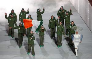 Ireland's flag-bearer Conor Lyne leads his country's contingent during the opening ceremony of the 2014 Sochi Winter Olympics