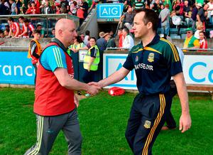 Louth manager Colin Kelly (L) congratulates Mick O'Dowd after Meath's win in last year's Leinster SFC – Kelly will be up against Andy McEntee this time. Photo: Paul Mohan/Sportsfile