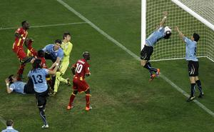 RED CARD: Luiz Suarez (9) handles the ball against Ghana during the 2010 World Cup. AP Photo/Themba Hadebe