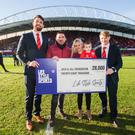 Pictured at the half-time presentation of a cheque for €28,000 in Thomond Park are Munster players Jean Kleyn and Chris Cloete, with Life Style Sports' David Reynolds and Jack and Jill representatives Una Quish and son Noah. Pic: Inpho/Tommy Dickson