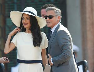 George Clooney, flanked by his wife Amal Alamuddin, arrives at the city hall for their civil marriage ceremony in Venice
