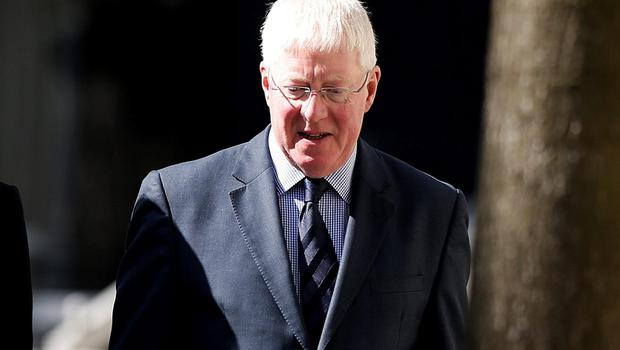 Malcom Layfield arrives at Manchester Crown Court to face charges of raping a pupil in the 1980's while he was a violin teacher at Chetham's music school Credit: Lynne Cameron/PA Wire