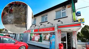 The targeted Spar in Clontarf, inset, the shattered door