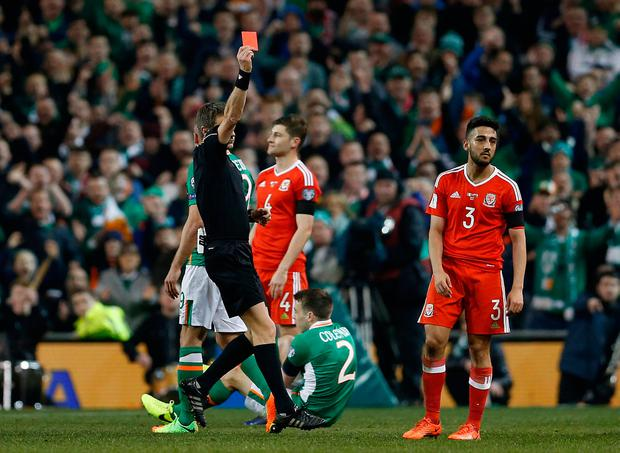 Wales' Neil Taylor is sent off by referee Nicola Rizzoli for a reckless tackle on Seamus Coleman. Reuters / Matthew Childs