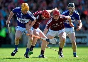 Galway's Niall Healy and Cathal Mannion, right, scramble for possession