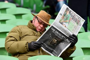 A man reads a Sunday newspaper in the stands ahead of the Six Nations international rugby union match between Ireland and England at Aviva Stadium in Dublin, Ireland on March 1, 2015 -  advertising with newspaper brands rose last year for the first time since 2007. AFP PHOTO / PAUL ELLISPAUL ELLIS/AFP/Getty Images