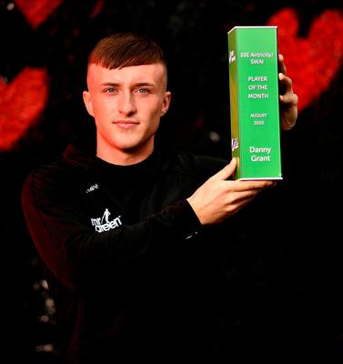 Danny Grant of Bohemians with his SSE Airtricity SWAI Player of the Month Award for August