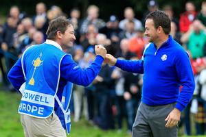 AUCHTERARDER, SCOTLAND - SEPTEMBER 28:  Graeme McDowell of Europe celebrates victory against Jordan Spieth of the United States with caddie Ken Comboy on the 17th hole during the Singles Matches of the 2014 Ryder Cup on the PGA Centenary course at the Gleneagles Hotel on September 28, 2014 in Auchterarder, Scotland.  (Photo by Harry How/Getty Images)