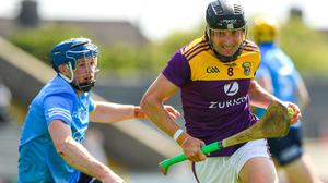 Liam Og McGovern of Wexford in action against Conor Burke of Dublin