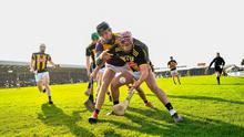 Ciaran Wallace of Kilkenny holds off a tackle from Wexford's Joe O'Connor. Photo: Ray McManus/Sportsfile