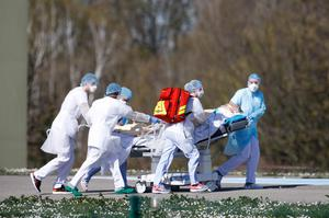 Transport: A victim of the virus is evacuated from the Mulhouse civil hospital in eastern France, at the epicentre of the outbreak in France. Picture: AP