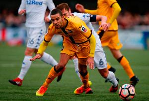 Leeds United's English-born Scottish defender Liam Cooper (hidden) is sent off for a second yellow for this foul on Sutton United's English midfielder Craig Eastmond. Photo: Getty Images