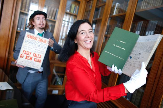 Role play: Rory Dignam as Sebastian Dangerfield, the main protagonist of 'The Ginger Man', with National Library of Ireland director Dr Sandra Collins. Photo: Julien Behal