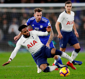 Tottenham's Danny Rose in action with Cardiff City's Joe Ralls. Photo: Matthew Childs/Reuters