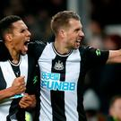 Florian Lejeune (right) celebrates scoring his and Newcastle's side's second goal with team-mate Isaac Hayden during the Premier League draw at Goodison Park