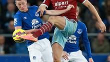 West Ham United's Andy Carroll (right) and Everton's James McCarthy battle for the ball during the Barclays Premier League match at Goodison Park