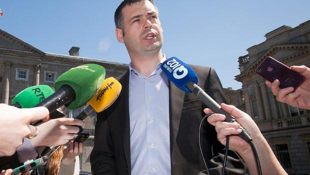 Pearse Doherty speaks to the media outside Leinster House yesterday. Photo: Gareth Chaney