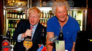 Pulling pints: Boris Johnson with Tim Martin, who is planning to expand his Irish operation. Photo: Henry Nicholls/PA Wire