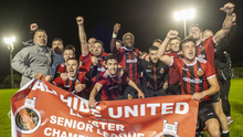 The Malahide United squad celebrate their historic title success at Gannon Park following the 5-0 victory in their final game against Newbridge Town last Friday evening (11th). Pictures: Fintan Clarke