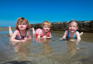 Twins Martha and Jane Devine from Marino [2] pictured with their older sister Grace [5] as they enjoy the sunshine at Burrow beach in Sutton. Picture Credit:Frank McGrath 22/6/18