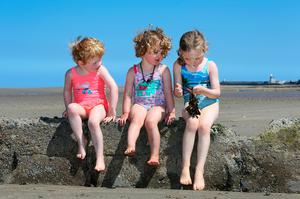 Five year old Grace Devine [right] from Marino pictured with her sisters Martha and Jane both 2 years old as they enjoy the sunshine at Burrow beach in Sutton. Picture Credit:Frank McGrath 22/6/18