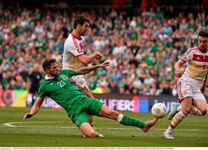 13 June 2015; Daryl Murphy, Republic of Ireland, in action against Charlie Mulgrew, Scotland. UEFA EURO 2016 Championship Qualifier, Group D, Republic of Ireland v Scotland, Aviva Stadium, Lansdowne Road, Dublin. Picture credit: David Maher / SPORTSFILE