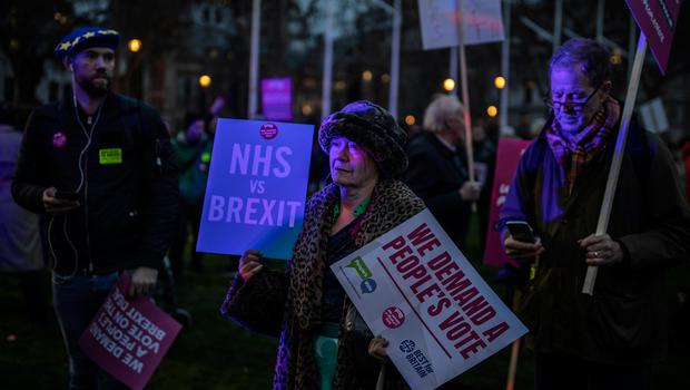 Protesters demonstrate on the day that MP's vote on Theresa May's Brexit deal, in Parliament Square   (Photo by Dan Kitwood/Getty Images)