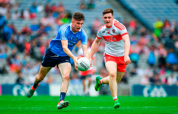 James Doran of Dublin in action against Pádraig McGrogan of Derry. Photo by Ramsey Cardy/Sportsfile