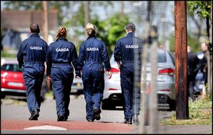 Probe: Gardaí at the scene of the shooting at Cromcastle Drive in Coolock, Dublin. Photo: Steve Humphreys
