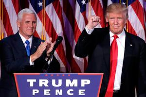 U.S. President-elect Donald Trump gestures as Vice President-elect Mike Pence applauds (L) at their election night rally in Manhattan, New York, U.S., November 9, 2016. REUTERS/Mike Segar