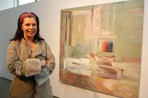 Irish Artist Diana Copperwhite at the Royal Hibernian Academy Gallagher Gallery, Dublin with a previous award winning work by her.