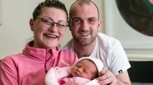 Sonya Burke with husband Colm and baby Maria. Photo: Mark Condren