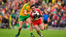 27 June 2015; Oisin Duffy, Derry, is tackled by Colm McFadden, Donegal. Ulster GAA Football Senior Championship, Semi-Final, Derry v Donegal. St Tiernach's Park, Clones, Co. Monaghan. Picture credit: Ramsey Cardy / SPORTSFILE