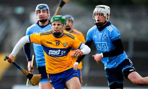Ian Galvin of Clare is tackled by Alex O'Neill of Dublin