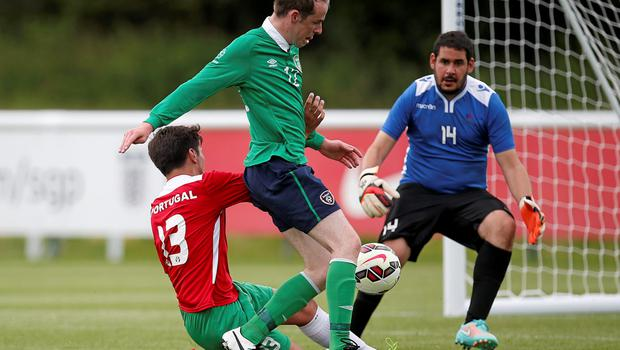 20 June 2015; Ryan Nolan, Ireland, advances towards the goal under pressure from Lucan Pinheiro, Portugal. This tournament is the only chance the Irish team have to secure a precious qualifying spot for the 2016 Rio Paralympic Games. 2015 CP Football World Championships, Ireland v Portuga. St. George's Park, Tatenhill, Burton-upon-Trent, Staffordshire, United Kingdom. Picture credit: Magi Haroun / SPORTSFILE