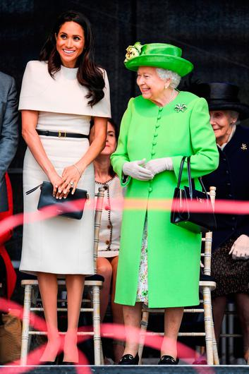 Queen Elizabeth II stands with Meghan, Duchess of Sussex during a ceremony to open the new Mersey Gateway Bridge on June 14, 2018 in the town of Widnes in Halton, Cheshire, England