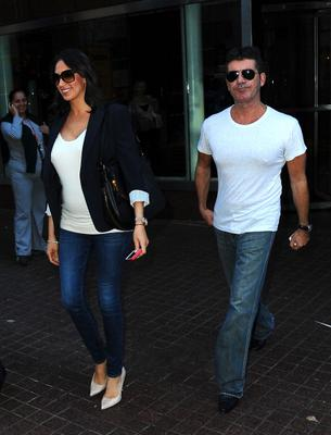 NEW YORK, NY - SEPTEMBER 19:  Lauren Silverman and Simon Cowell are seen in Soho on September 19, 2013 in New York City.  (Photo by Raymond Hall/FilmMagic)