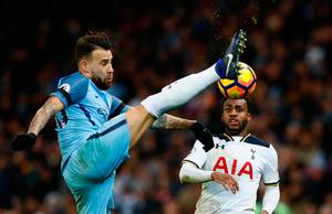 Manchester City's Nicolas Otamendi in action with Tottenham's Danny Rose. Photo: Reuters / Jason Cairnduff