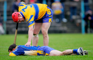 Lohan checks on Fitzgerald during a league match in 2005 during their spell as Clare team-mates. Photo: Kieran Clancy / Sportsfile