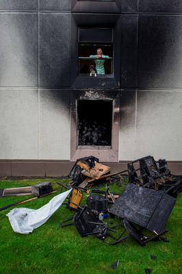 Wednesday 23 September 2015. Cromcastle Court fire. Sandra Ivers and her dog Tyson from the flat above.